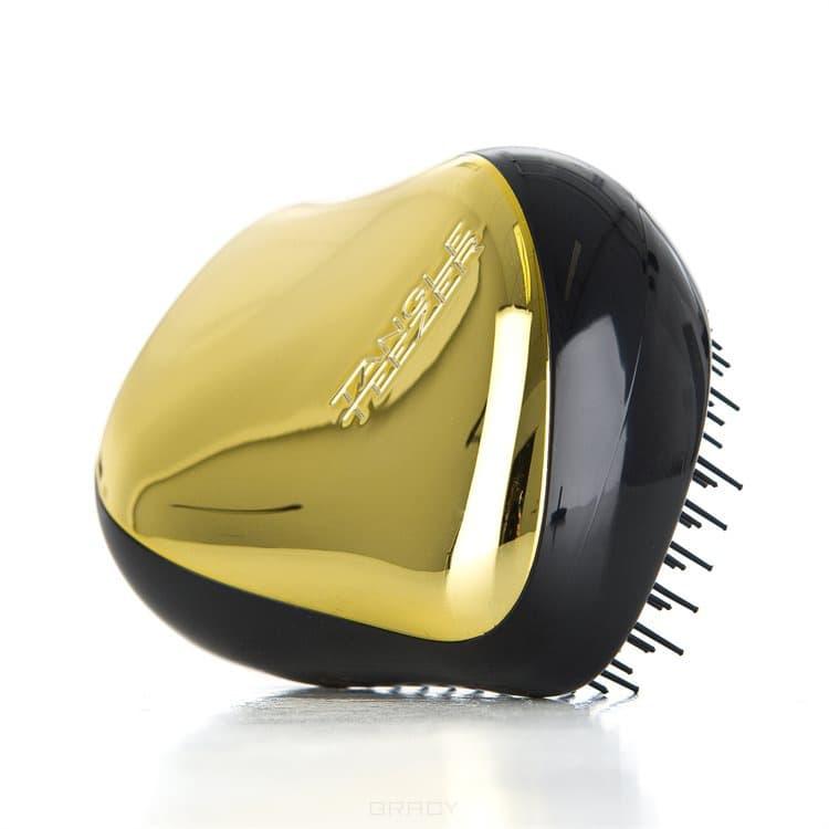 Расческа для волос Compact Styler Gold RushTangle Teezer Compact Styler - профессиональная расческа, отлично подходит для всех типов волос. Оригинальная и уникальная форма зубчиков обеспечивает двойное действие позволяет расчесать сухие и влажные волосы легко и быстро, без рывков и усилий. &#13;<br>Расческа мягко скользить по волосам, распутывая их, сводя к минимуму разрушение и выпадение волос. Идеальна при нанесении кондиционера на ваши волосы, обеспечивает легкое и равномерное распределение средства на волосы, фиксирует ваши пряди при дальнейшей сушке феном.&#13;<br> &#13;<br>Расческа Tangle Teezer идеальна для расслабляющего массажа головы. Расческа стала более компактной и удобной для переноски, на зубчики одевается защитный колпачок, предохраняющий их от повреждений. Благодаря эргономичной форме расческа удобно ложиться в ладонь, позволяя более творчески подойти к процессу укладки. &#13;<br>   &#13;<br>    &#13;<br>   &#13;<br> &#13;<br>  Особенности расчески Tangle Teezer Compact Styler:&#13;<br> &#13;<br>   &#13;<br>    &#13;<br>   &#13;<br> &#13;<br>  Подходит для всех типов волос&#13;<br> &#13;<br>  Идеально подходит при р...<br>
